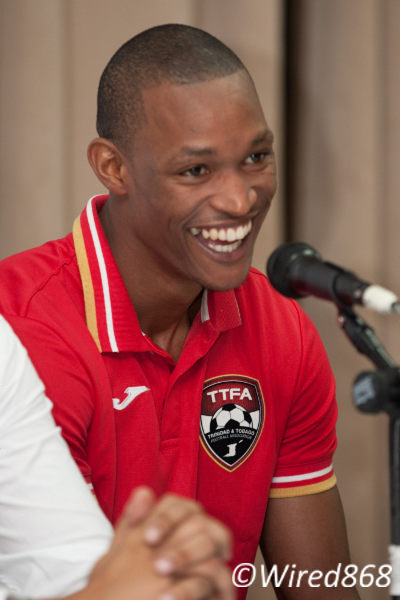 Photo: Ataullah Guerra speaks to the press after his international friendly strike against Jamaica last November. (Courtesy Allan V Crane/Wired868)