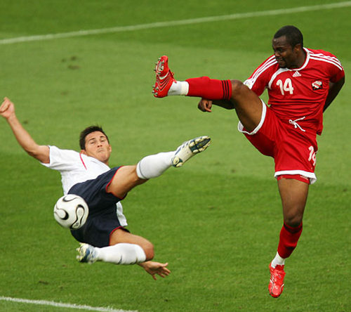 Photo: Record Trinidad and Tobago goal scorer Stern John (right) challenges England midfielder and Chelsea legend Frank Lampard during the Germany 2006 World Cup.