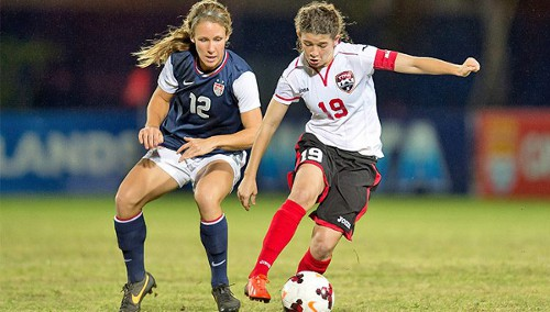 Photo: Trinidad and Tobago captain Anique Walker (right) shields the ball from United States player Mallory Weber. (Courtesy Wired868)