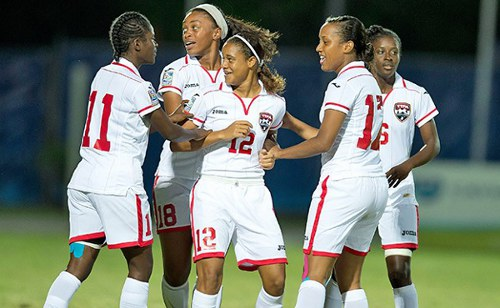 Photo: Don't hold her back! Trinidad and Tobago midfielder Shanisa Camejo (centre) celebrates a goal with teammates (from left) Khadidra Debesette, Liana Hinds, Jonelle Warrick and Khadisha Debesette during the 2014 CONCACAF Under-20 Championships. (Courtesy CONCACAF.com)