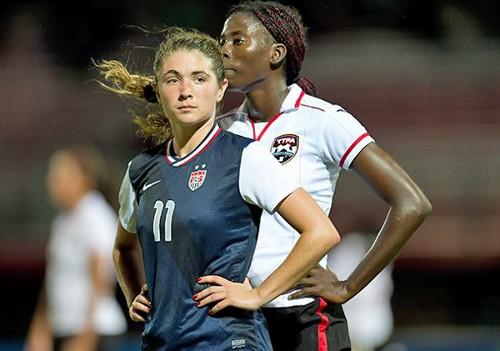 Photo: Trinidad and Tobago defender Daniella Findley (right) tries to keep close to United States striker McKenzie Meehan. (Courtesy CONCACAF.com)
