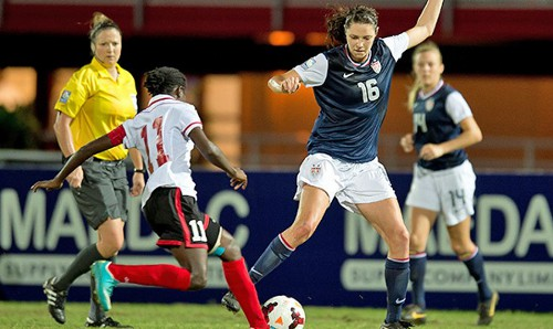 Photo: Trinidad and Tobago midfielder and stand-in captain Khadidra Debesette (left) tries in vain to get around giant United States midfielder Stephanie Amack. (Courtesy CONCACAF.com)