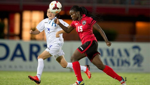 Photo: Trinidad and Tobago utility player Khadisha Debesette (right) tracks down Honduras player Dania Reyes during a group contest. (Courtesy CONCACAF.com)