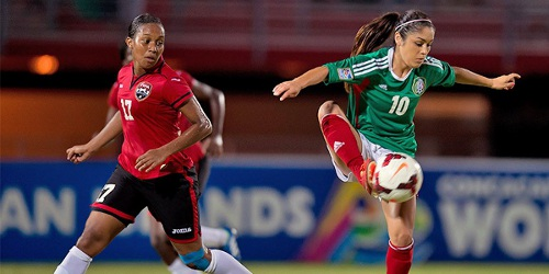Photo: Trinidad and Tobago defender Jonelle Warrick (left) tries to close down Mexico attacker Paloma Zermeno. (Courtesy MexSport/CONCACAF)