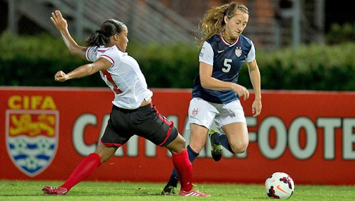 Photo: United States attacker Summer Green (right) goes past Trinidad and Tobago defender Jonelle Warrick. (Courtesy Wired868)