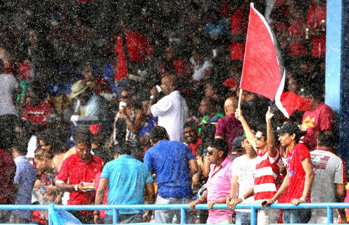 Photo: West Indies cricket fans brave the rain in hope of some action.
