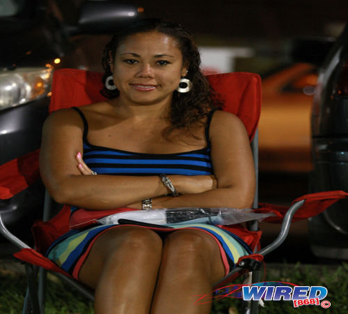 Photo: Leanna Lewis, wife of Strike Squad star Leonson Lewis, enjoys the action. (Courtesy Allan V Crane/ Wired868)