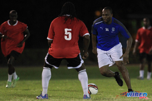 Photo: Record Trinidad and Tobago goal scorer Stern John (right) runs at his former 2006 World Cup teammate Brent Sancho. (Courtesy Allan V Crane/ Wired868)