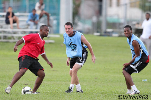 Photo: Former Trinidad and Tobago national youth team striker Marvin Joseph (far left) tries to find a way past Terry Fenwick (centre) and Carlyle Mitchell at the 2013 Wired868 Football Festival. (Courtesy Allan V Crane/Wired868)