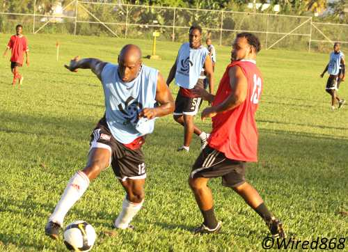 Photo: Former Trinidad and Tobago star striker Leonson Lewis (left) evades Ricky Aleong during the inaugural Wired868 Football Festival. (Courtesy Noel Saldenha/Wired868)