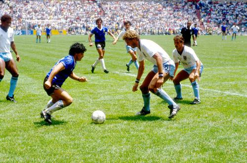 Photo: Argentina football legend Diego Maradona (second from left) prepares to drive past England defenders Terry Butcher (second from right) and Kenny Sansom (far right) while John Barnes looks on.