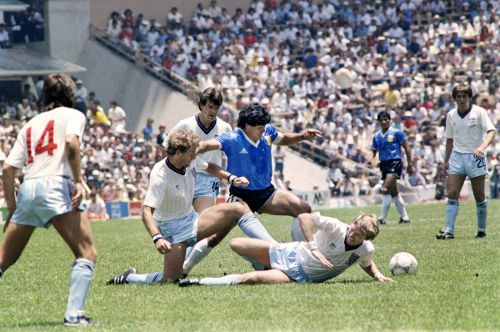 Photo: Argentina captain and football icon Diego Maradona (centre) weaves past a troop of England players during their famous 1986 World Cup quarterfinal clash. (Copyright AFP 2014)