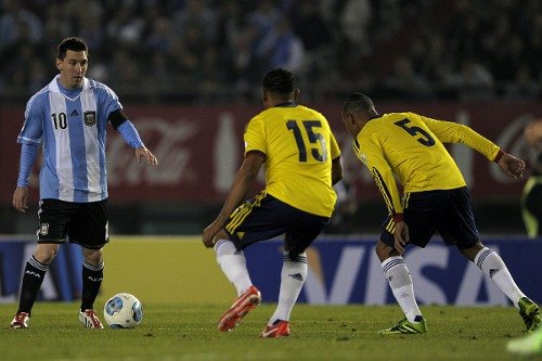 Photo: Argentina's Lionel Messi (left) sizes up Colombian defenders Alexander Mejia (centre) and Aldo Leao Ramirez during a World Cup qualifier in Buenos Aires.  (Copyright AFP 2014/Alejandro Pagni)
