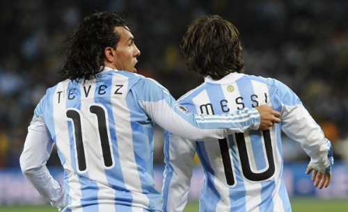 Photo: Argentina stars Lionel Messi (right) and Carlos Tevez played together at the 2006 and 2010 World Cups. (Courtesy Daniel Garcia/ AFP)