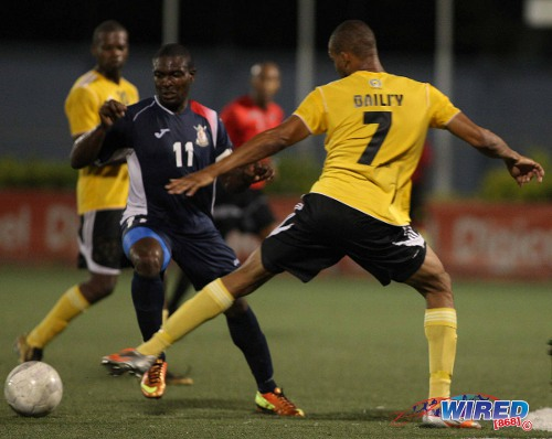 Photo: Defence Force winger Kevon Carter (left) glides past T&TEC player Christian Bailey during a Pro League match last season. (Courtesy Wired868)