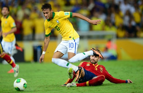 Photo: Spain's defender Gerard Pique (right) trips Brazil's forward Neymar during the 2013 Confederations Cup final in Rio de Janeiro. (Courtesy Christophe Simon/ AFP)