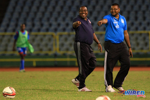 Photo: Caledonia head coach Jamaal Shabazz (left) and assistant coach Rajesh Latchoo enjoy a good day at the office. The mood has not been as good in the Central FC camp. (Courtesy Allan V Crane/ Wired868)