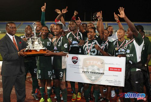 Photo: TTFA president Raymond Tim Kee (far left) presents the 2013 FA Trophy to Pro League club DIRECTV W Connection. (Courtesy Wired868)