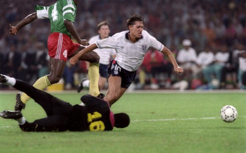Photo: England striker Gary Lineker (right) goes down under a challenge from Cameroon defender Thomas N'Kono during the 1990 World Cup quarterfinal. (Courtesy Patrick Hertzog/ AFP)