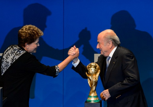 Photo: Brazil president Dilma Rousseff (left) and FIFA president Sepp Blatter. (Courtesy Fabrice Coffrini/ AFP)