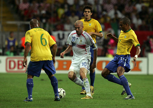 Photo: France captain Zinedine Zidane (centre) is surrounded by Brazil players Roberto Carlos (left), Gilberto Silva (right) and Kaka during the 2006 World Cup. (Courtesy PA Photos)