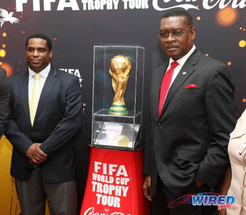 Photo: TTFA president Raymond Tim Kee (right) and general secretary Sheldon Phillips pose with the FIFA World Cup trophy. (Courtesy Wired868)