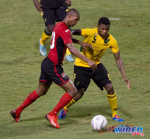 Photo: Trinidad and Tobago and Central FC midfielder Ataulla Guerra (left) battles with Jamaican opponent Alvas Powell during a friendly international. (Courtesy Allan V Crane/ Wired868)