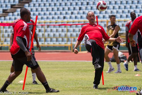Photo: Trinidad and Tobago head coach Stephen hart (right) juggles the ball while goalkeeping coach Jefferson George looks on. (Courtesy Allan V Crane/ Wired868)