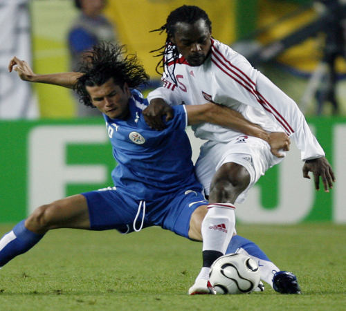 Photo: Former Trinidad and Tobago defender Brent Sancho (right) in action against Paraguay attacker Roberto Acuna at the 2006 World Cup in Germany.