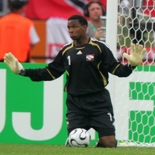 Photo: Trinidad and Tobago goalkeeper Shaka Hislop calms everyone down during the nation's 2006 World Cup opening group match against Sweden. (Courtesy Roberto Schmidt/ AFP)