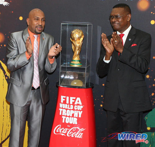 Photo: Trinidad and Tobago Football Association (TTFA) president Raymond Tim Kee (right) and former Sport Minister Anil Roberts at the FIFA World Cup trophy tour in 2013. (Courtesy Wired868)
