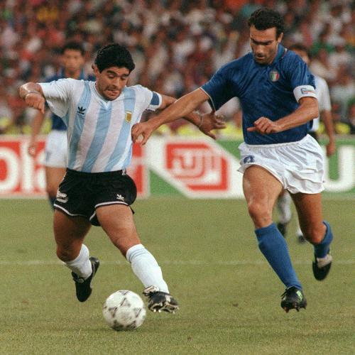Photo: Argentina legend Diego Maradona (left) keeps the ball from Italy defender Guiseppe Bergomi during the 1990 World Cup. (Copyright AFP 2014/Daniel Garcia)