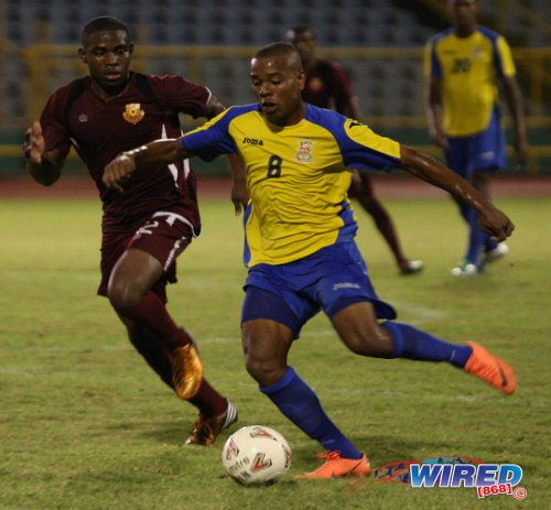 Photo: Defence Force midfielder Curtis Gonzales (right) looks for a teammate while North East Stars midfielder Keithy Simpson looks on. Gonzales and his teammates failed to advance past the CFU stage of the CONCACAF Champions League for the second time in three years. (Courtesy Wired868)