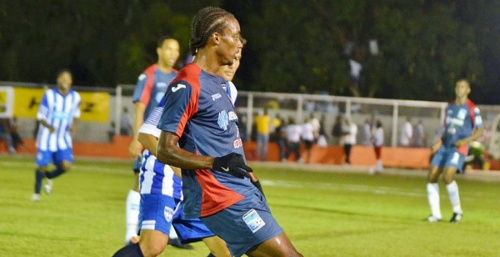 Photo: Caledonia AIA midfielder Tyrone Charles (centre) in action on the opening day of the CFU tournament. Charles has scored in both matches for Caledonia AIA thus far. (Courtesy CONCACAF)