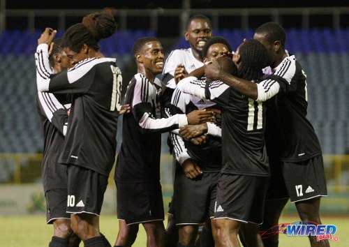 Photo: Central FC celebrates en route to the 2013 First Citizens Cup crown earlier in the season. (Courtesy Wired868)