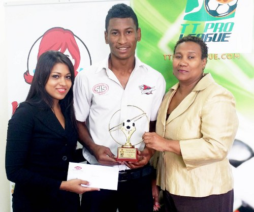 Photo: Central FC striker Willis Plaza (centre) receives his Wendy's Player of the Month award from Wendy's marketing officer Melita Sharma (left) while Pro League secretary Julia Baptiste looks on. (Courtesy TT Pro League)