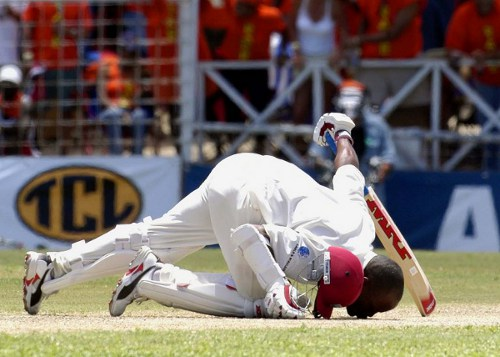Photo: West Indian batsman Brian Lara kisses the ground after his record breaking 385 against England in Antigua on 12 April 2004. (Copyright AFP 2014/Alessandro Abbonizio)
