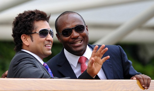 Photo: Cricket legends Brian Lara (right) and Sachin Tendulkar enjoy each other's company at the 2010 Wimbledon finals. (Copyright AFP 2014/Adrian Dennis)