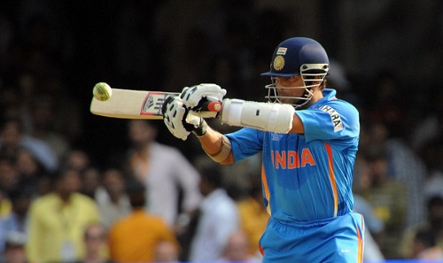 Photo: India cricketer Sachin Tendulkar plays a shot in an ODI against England. (Copyright AFP 2014/Prakash Singh)