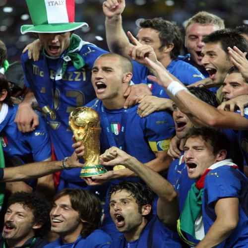 Photo: Italy celebrates with the 2006 World Cup trophy. (Copyright AFP 2014/Patrik Stollarz)