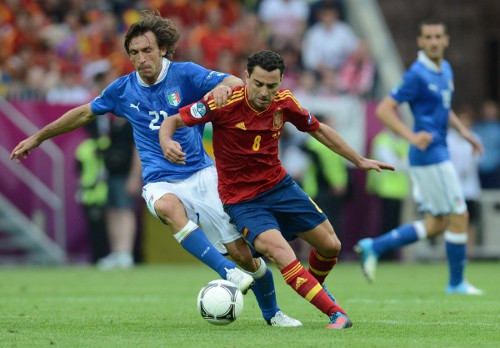 Photo: Italy playmaker Andrea Pirlo (left) battles with Spain star Xavi.