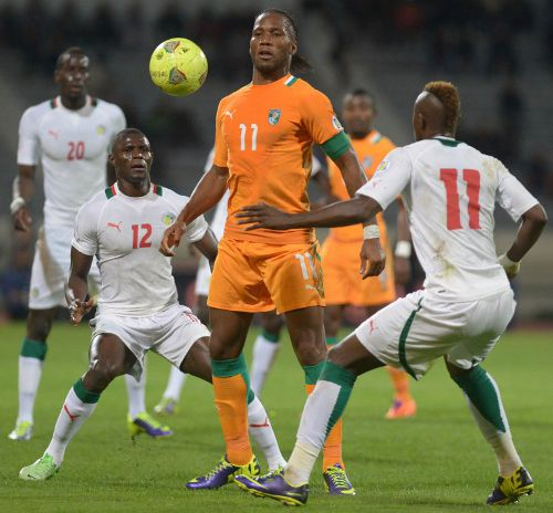 Photo: Ivory Coast striker and captain Didier Drogba (centre) stands and delivers during a World Cup play off against Senegal. (Copyright AFP 2014/ Fadel Senna)