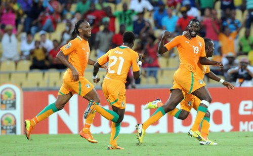 Photo: Ivory Coast stars Yaya Toure (third from left) and captain Didier Drogba (far left) are anxious for success at the 2014 World Cup. (Copyright AFP 2014/ Alexander Joe)