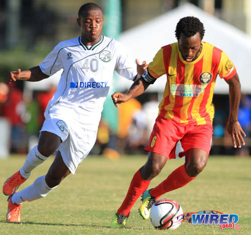 "Photo: Point Fortin Civic midfielder Kelvin ""Supers"" Modeste (right) keeps the ball from W Connection midfielder Jomal Williams during an earlier Pro League contest. (Courtesy Allan V Crane/Wired868)"