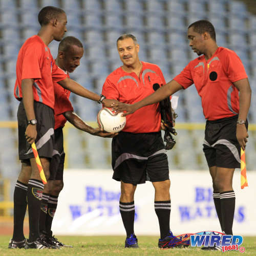 Photo: Referee Larry Lalchan (centre) and fourth official Gordon Maloney (second from left) share a moment before kick off during a Pro League contest last season. Maloney was fourth official yesterday in a controversial National Super League affair. (Courtesy Allan V Crane/Wired868)