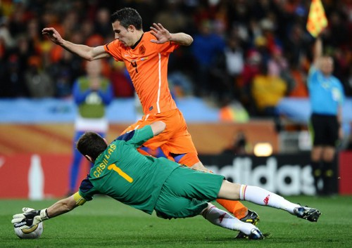 Photo: Spain goalkeeper and captain Iker Casillas dives to thwart Netherlands striker Robin Van Persie (background) during the 2010 World Cup final in South Africa. (Copyright AFP 2014/Jewel Samad)