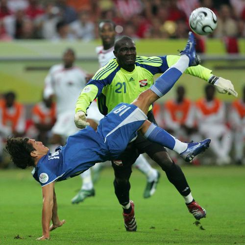 Photo: Trinidad and Tobago goalkeeper Kelvin Jack wrestles with Paraguay forward Nelson Valdez (left) during the 2006 World Cup. (Copyright AFP 2014/Roberto Schmidt)