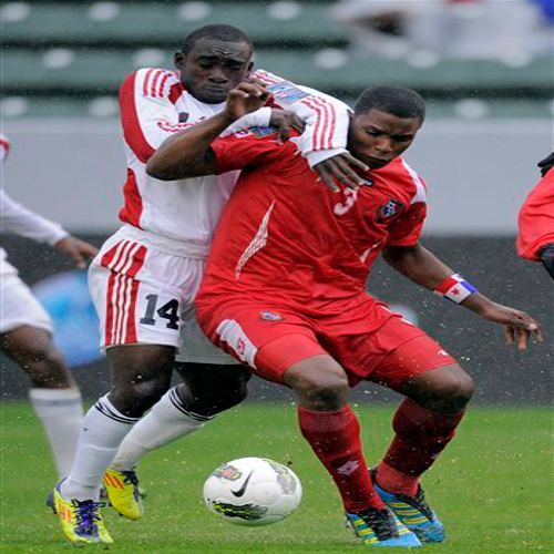 Photo: Trinidad and Tobago forward Trevin Caesar (left) tries to wrestle the ball from Panama player Harold Cummings during the London 2012 Olympic qualifying series. (Courtesy Yahoo Sports)