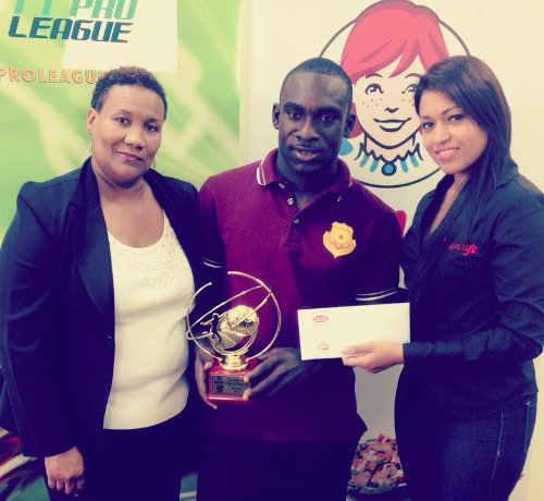Photo: North East Stars striker Trevin Caesar (centre) collects his award from Wendy's marketing officer Melita Sharma (right) while Pro League secretary Julia Baptiste looks on. (Courtesy TT Pro League)