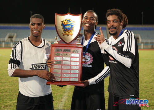Photo: Central FC players (from left) Elton John, Yohance Marshall and captain Marvin Oliver pose with the 2014 Lucozade Sport Goal Shield trophy. (Courtesy Allan V Crane/Wired868)